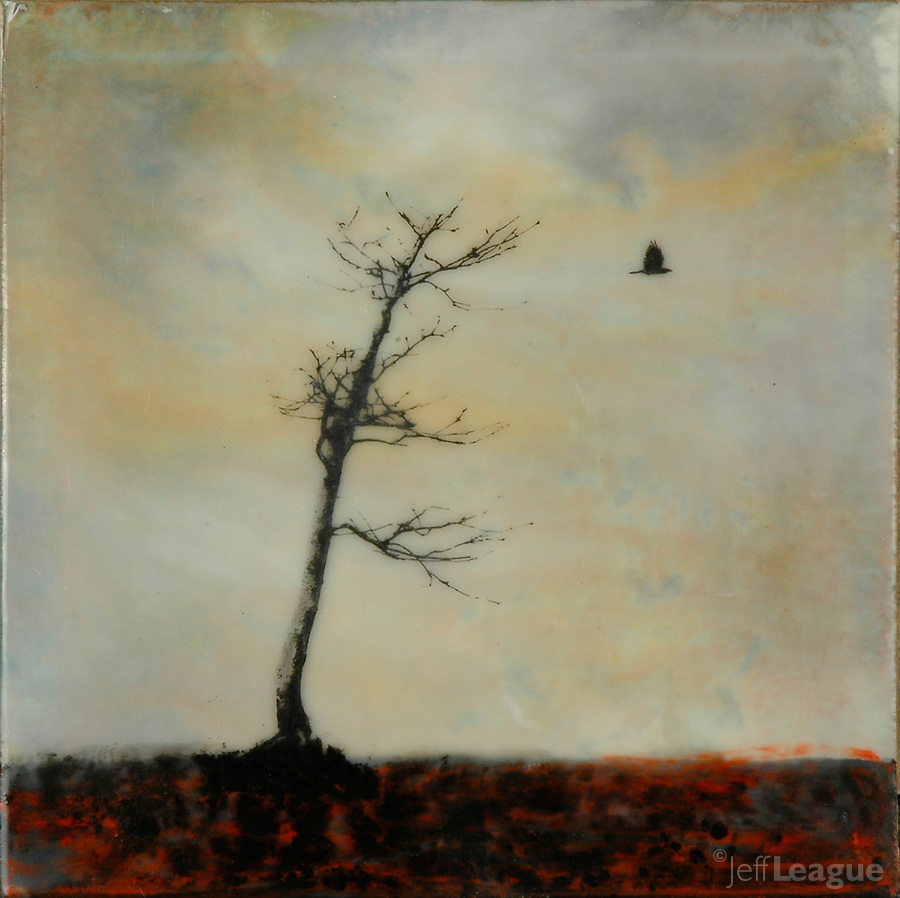 Mixed media encaustic photo transfer of bare tree with crow in gray gold sky.