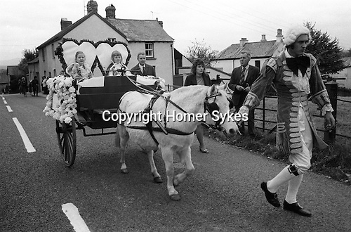 Hatherleigh Fire Festival. Hatherleigh, Devon England 1973. Childrens parade in afternoon. November.