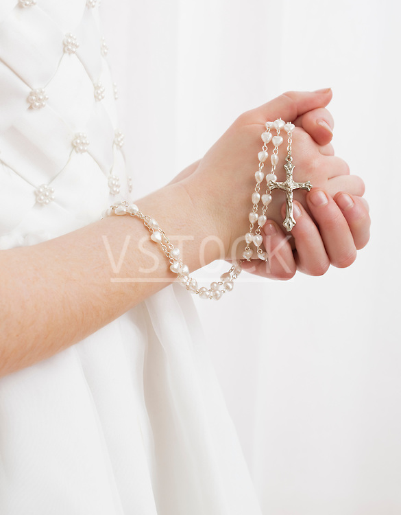 Mid-section of (8-9) praying with rosary beads