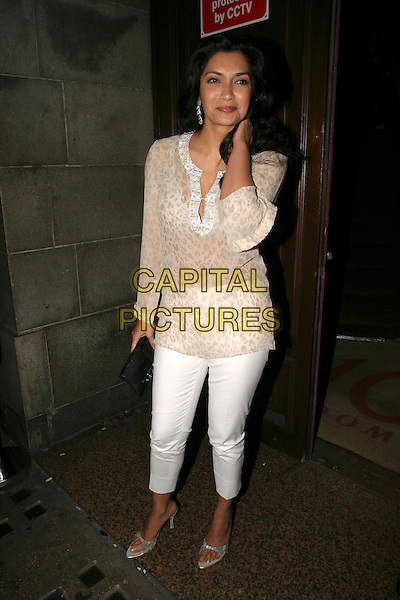 FARIA ALAM.Celebrity Big Brother Party, .Astor Bar & Grill, Glasshouse Street, .London, England, 30th January 2006..full length white cropped trousers leopard print sheer kaftan floaty top .Ref: AH.www.capitalpictures.com.sales@capitalpictures.com.©Adam Houghton/Capital Pictures.