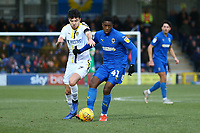 Michael Folivi of AFC Wimbledon and Scott Fraser of Burton Albion during AFC Wimbledon vs Burton Albion, Sky Bet EFL League 1 Football at the Cherry Red Records Stadium on 9th February 2019