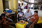 ETHIOPIA , Dire Dawa / AETHIOPIEN, Dire Dawa, katholische Kirche unterstuetzt arme Jugendliche mit einem Mittagessen, Kapuziner Fr. Worku Demeke im Gespraech mit Jugendlichen, Fitsub Belay 18 Jahre (Coca Cola T-shirt)