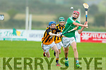Andrew Murphy of Ballyduff attempts to get his shot away despite the attention from Abbeydorney's Michael O'Sullivan in the U16 Co Hurling Championship final in Lerrig on Sunday