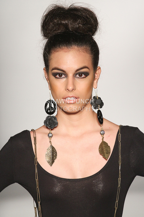Model walks runway wearing jewelry from the Tsion Rocks Fall 2015 collection by Yvette Crocker, during the Accessories Premier Fall Winter 2015 fashion show for  Fashion Gallery New York Fashion Week Fall 2015.