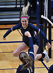Althoff player Karinna Gall leaps for joy after Althoff scored. In front is teammate Mary Wessel pumping her fist in the air. Althoff lost to Minooka in the championship game of the O'Fallon Class 4A volleyball sectional at O'Fallon HS in O'Fallon, IL on November 6, 2019.<br /> Tim Vizer/Special to STLhighschoolsports.com
