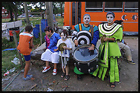 A group of children dressed in Murga costumes waits for Contrafarsa outside the abandoned bar in Sayago moments before inaugural parade of the Uruguayan Carnival, January 30, 2004.
