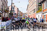 The cyclist climb the steep hill into Killorglin town during the final the stage of Ras Mumhan in Killorglin on Monday