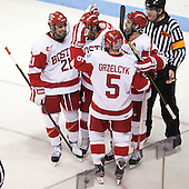 Sean Escobedo (BU - 21), Sahir Gill (BU - 28), Matt Grzelcyk (BU - 5), Wade Megan (BU - 18), Tim Low - The Boston University Terriers defeated the visiting Northeastern University Huskies 5-0 on senior night Saturday, March 9, 2013, at Agganis Arena in Boston, Massachusetts.
