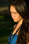 Hawaii: Molokai, young woman at protocol spiritual ceremonies at Kaupoa Beach..Photo himolo211-71987..Photo copyright Lee Foster, www.fostertravel.com, lee@fostertravel.com, 510-549-2202