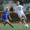 St. Anthony's No. 14 Kayla Arestivo, right, looks to move the ball upfield as Kellenberg No. 2 Kylie Roberts pressures her during the NSCHSAA varsity girls' soccer Class AA championship played at St. John the Baptist High School on Thursday, October 29, 2015. St. Anthony's won by a score of 3-0.<br /> <br /> James Escher