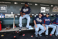 SAN FRANCISCO - APRIL 9:  Jason Heyward (left), Brian McCann and Jesse Chavez of the Atlanta Braves get ready in the dugout before the game between the Atlanta Braves and the San Francisco Giants on Friday, April 9, 2010, at AT&T Park in San Francisco, California.  The Giants defeated the Braves 5-4.  (Photo by Brad Mangin)