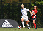 Duke's Elisabeth Redmond (16) is held by NC State's Michelle Massey (4) on Sunday, October 1st, 2006 at Koskinen Stadium in Durham, North Carolina. The Duke Blue Devils defeated the North Carolina State University Wolfpack 3-0 in an Atlantic Coast Conference NCAA Division I Women's Soccer game.