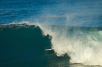 Oahu/Hawaii (Wednesday, December 8, 2010) -  Tyler Wright (AUS) tucking into a barrel at Off The Wall. . .Photo: joliphotos.com