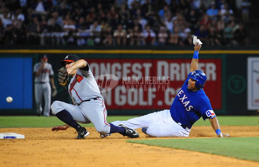 Jun. 18, 2008; Arlington, TX, USA; Texas Rangers base runner Marlon Byrd safely steals second base as Atlanta Braves second baseman (2) Kelly Johnson cant catch the ball to make the tag at the Rangers Ballpark. Mandatory Credit: Mark J. Rebilas-