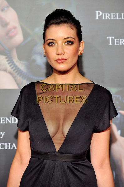 DAISY LOWE.Attends the Pirelli Calendar 2010 Gala Dinner, Old Billingsgate, Old Billingsgate Walk, London, England, UK,.20th November 2009..half length black dress sheer see through thru boobs cleavage breasts v-neck gold earrings hair up .CAP/PL.©Phil Loftus/Capital Pictures.