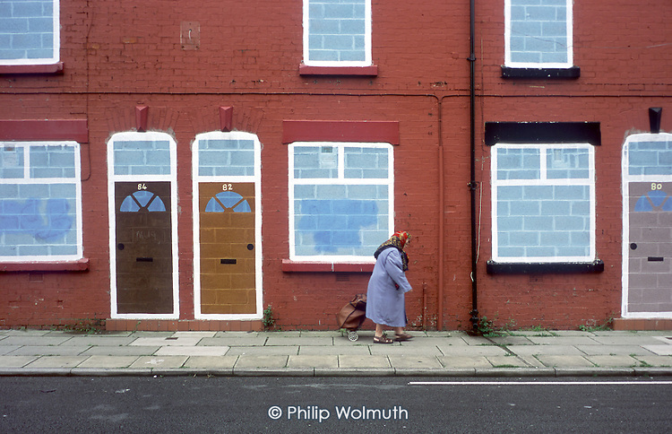 "Terraced street of empty houses belonging to Riverside Housing Association in Liverpool 8.  The city council plans to demolish 6000 properties suffering from ""low demand""."