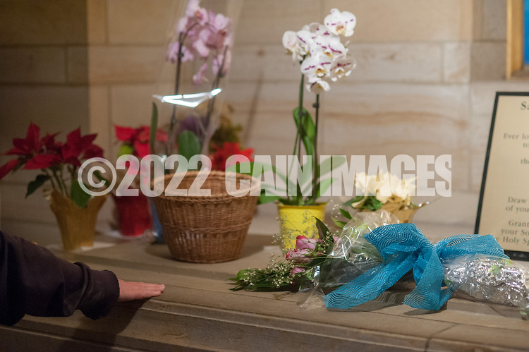 One of the last visitors, Colleen Mooney-Coughlin of Bensalem, Pennsylvania places her hand on the tomb of St. Katharine Drexel at the National Shrine of St. Katharine Drexel Saturday, December 30, 2017 in Bensalem, Pennsylvania. Drexel was an American heiress who dedicating herself to work among the American Indians and African-Americans in the western and southwestern United States. She was canonized a saint by the Roman Catholic Church in 2000. (Photo by William Thomas Cain/Cain Images)
