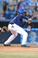 Asheville Tourists left fielder Raimel Tapia #15 squares to bunt during opening night game against the Delmarva Shorebirds at McCormick Field on April 3, 2014 in Asheville, North Carolina. The Tourists defeated the Shorebirds 8-3. (Tony Farlow/Four Seam Images)