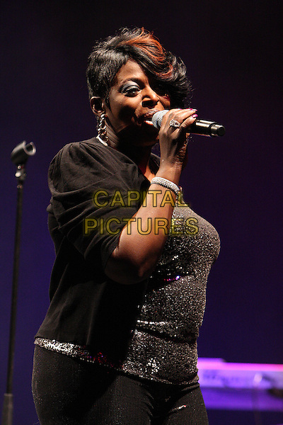 ANGIE STONE.Performing live at the Hammersmith Apollo, London, England..March 5th, 2010.stage concert gig performance music half length black jacket top singing .CAP/MAR.© Martin Harris/Capital Pictures.