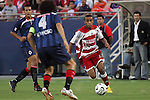 24 July 2007:  Ricardinho (34) of FC Dallas moves the ball straight at Hector Reynoso (4) of CD Guadalajara.  This was Ricardinho's first appearance in an FC Dallas uniform.  FC Dallas tied Chivas de Guadalajara 1-1 at Pizza Hut Park in Frisco, Texas, in the opening match of SuperLiga 2007.