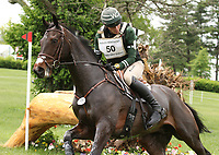 LEXINGTON, KY - April 29, 2017. #50 Fernhill Classic and Ryan Wood from Australia narrowly escape elimination at #7 The Frog Pond during the Rolex Cross Country test at the Kentucky Horse Park.  Lexington, Kentucky. (Photo by Candice Chavez/Eclipse Sportswire/Getty Images)