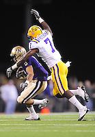 Sept. 5, 2009; Seattle, WA, USA; Washington Huskies wide receiver (9) Devin Aguilar is tackled by LSU Tigers cornerback (7) Patrick Peterson at Husky Stadium. Mandatory Credit: Mark J. Rebilas-