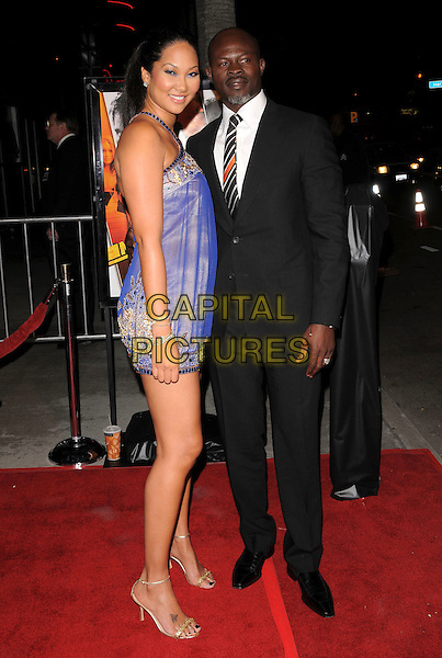 "KIMORA LEE & DJIMON HOUNSOU.Attends The Summit Entertainment Premiere of ""Never Back Down"" held at The Arclight in Hollywood, California, USA,  March 04 2008.                                                                                  .full length purple dress black suit tie white shirt.CAP/DVS.??Debbie VanStory/Capital Pictures"