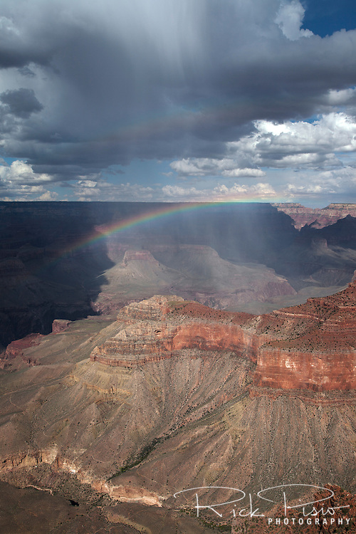 A summer rain squall passes over the Grand Canyon