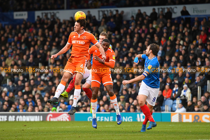 Ben Heneghan of Blackpool wins a header during Portsmouth vs Blackpool, Sky Bet EFL League 1 Football at Fratton Park on 12th January 2019