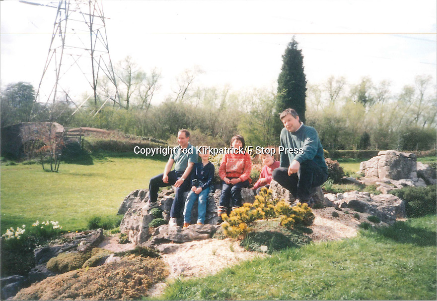 Collect photo from 1996 (estimate).<br /> <br /> Family friends: Phil and Sue Powell with their children, James and George sit with John Massey (right) on the new rockery.<br /> <br /> <br /> All Rights Reserved: F Stop Press Ltd. +44(0)1773 550665   www.fstoppress.com 27/10/16<br />
