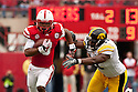 25 November 2011: running back Ameer Abdullah #8 of the Nebraska Cornhuskers runs between the tackles against the Iowa Hawkeyes at the Memorial Stadium in Lincoln, Nebraska. Nebraska defeated Iowa 20 to 7.