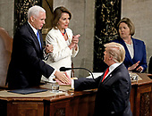 United States President Donald J. Trump shakes hands with US Vice President Mike Pence after delivering his second annual State of the Union Address to a joint session of the US Congress in the US Capitol in Washington, DC on Tuesday, February 5, 2019.  At center is Speaker of the US House of Representatives Nancy Pelosi (Democrat of California).<br /> Credit: Alex Edelman / CNP