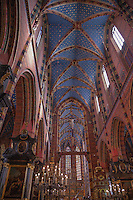 Neo-Gothic painting on the choir walls and a starry blue ceiling grace the interior of St. Mary's Church in Krakow
