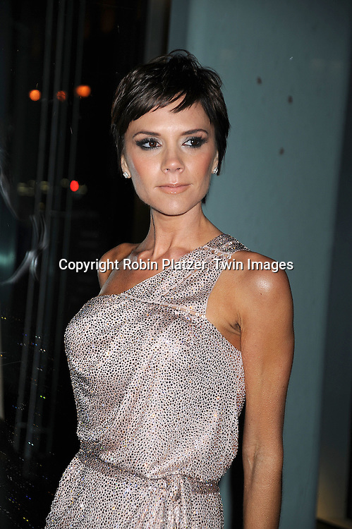 Victoria Beckham in Giorgio Armani dress..arriving at The Armani/ 5th Avenue Store Opening at 717 Fifth Avenue in New York City on February 17, 2009.....Robin Platzer, Twin Images