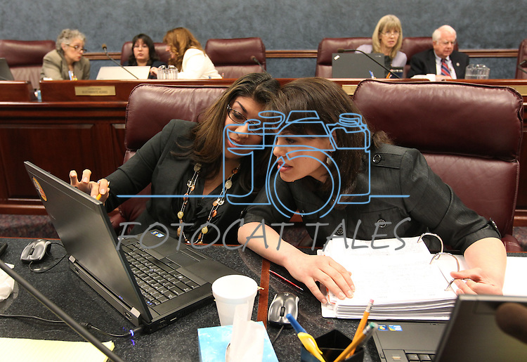 Nevada Assembly Democrats Lucy Flores, left, and Teresa Benitez-Thompson work in committee on Thursday, April 28, 2011, at the Legislature in Carson City, Nev. .Photo by Cathleen Allison