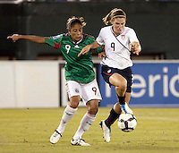 Maribel Dominguez of Mexico (L) and Heather O'Reilly of USA (R) during the semifinal match of CONCACAF Women's World Cup Qualifying tournament held at Estadio Quintana Roo in Cancun, Mexico. Mexico 2, USA 1.