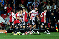 Sergi Canos of Brentford kisses goalscorer, Josh McEachran on the top of his head to celebrate Brentford's opening goal during Brentford vs Birmingham City, Sky Bet EFL Championship Football at Griffin Park on 2nd October 2018