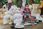 Having just crossed the border from Myanmar, a Rohingya boy waits for his family to complete registration in the Kutupalong Refugee Camp near Cox's Bazar, Bangladesh. More than 600,000 Rohingya refugees have fled government-sanctioned violence in Myanmar for safety in this and other camps in Bangladesh.