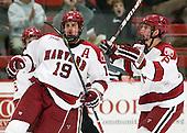 Alex Killorn (Harvard - 19) (Fallstrom) and Patrick McNally (Harvard - 8) celebrates Killorn's goal. - The Harvard University Crimson defeated the University of New Hampshire Wildcats 7-6 on Tuesday, November 22, 2011, at Bright Hockey Center in Cambridge, Massachusetts.