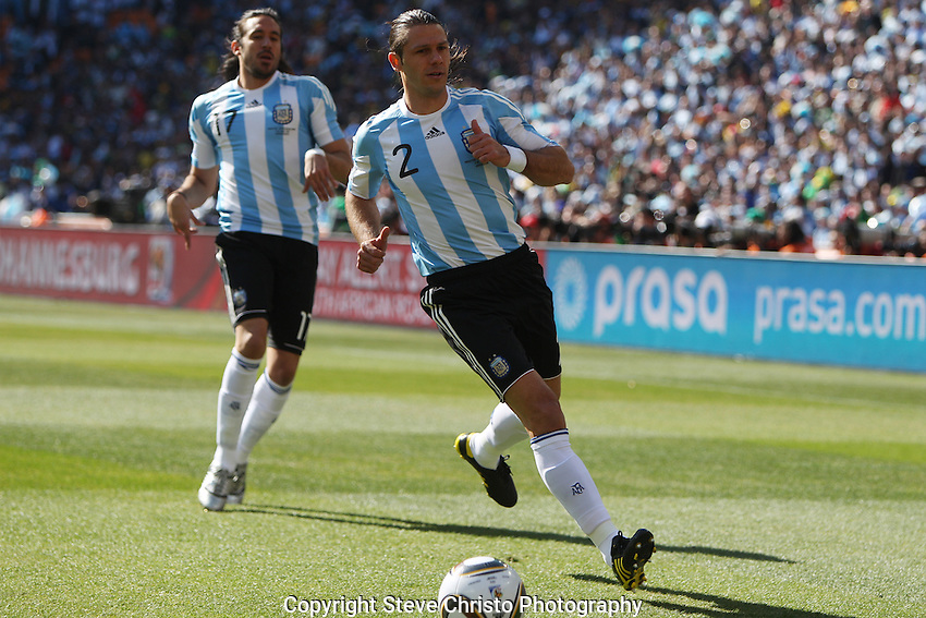 Argentina's Martín Demichelis let's the ball go through for a goal kick during the match against South Korea at National Stadium, Johannesburg, South Africa. Wednesday 17th June 2010. (Photo: Steve Christo)