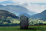 Mountainous landscape with historic stone monument in valley in England