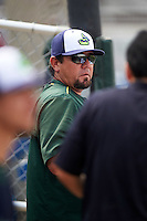 Vermont Lake Monsters pitching coach Carlos Chavez (35) in the dugout during a game against the Auburn Doubledays on July 13, 2016 at Falcon Park in Auburn, New York.  Auburn defeated Vermont 8-4.  (Mike Janes/Four Seam Images)