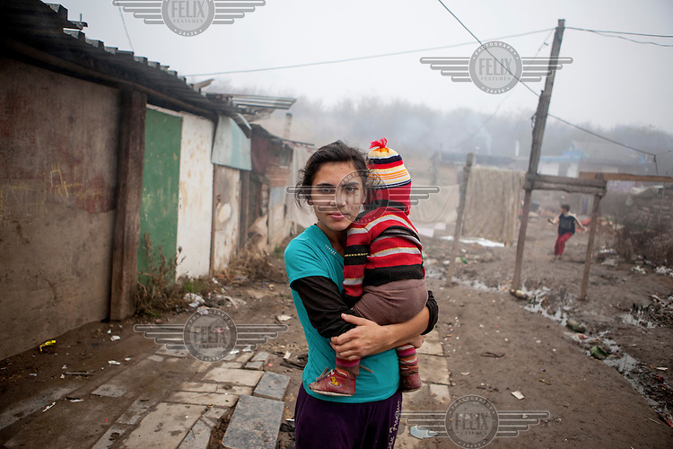 Mother with her child in the Roma settlement located in 'Budulovskej Street'.