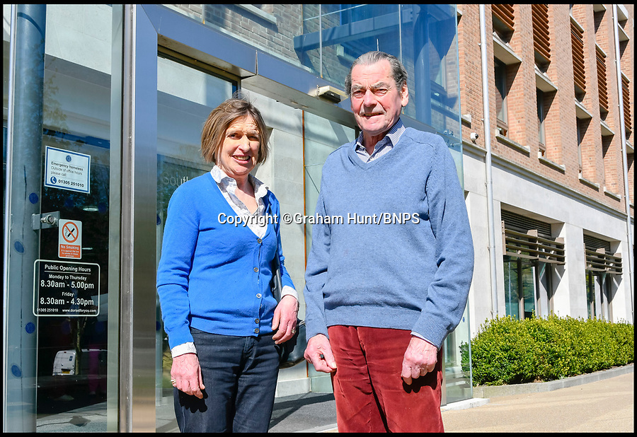 BNPS.co.uk (01202 558833)<br /> Pic: GrahamHunt/BNPS<br /> <br /> Captain Nigel Thimbleby and his wife Katharine outside West Dorset District Council planning meeting yesterday.<br /> <br /> Owners of Historic Wolfeton House in Dorset have won they're fight to remain far from the madding crowd.<br /> <br /> The elderly aristocrats yesterday repulsed a bid to build homes overlooking they're Elizabethan pile on the outskirts of Dorchester in Dorset, after local villagers and Julian Fellowes backed their campaign to keep the developers at bay.<br /> <br /> Downton Abbey creator Lord Julian Fellowes was one of about 100 people who objected to the proposal for 120 houses on land just 200 yards from Wolfeton House near Dorchester, Dorset.<br /> <br /> The house was owned for 400 years by the Trenchard family, whose name provided the inspiration for the main character in Hardy's classic 1886 novel The Mayor of Casterbridge.