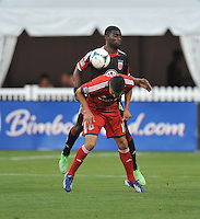 Luis Silva (11) of Toronto FC gets fouled by Brandon McDonald (4) of D.C. United. Toronto FC defeated D.C. United 2-1, at RFK Stadium, Saturday June 15 , 2013.