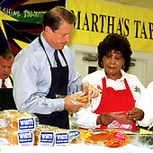 United States Vice President Al Gore prepares sandwiches at Martha's Table, a shelter that provides meals to the homeless in Washington, D.C. on 15 October, 1999.  Olivia Ivy, Director of Operations at Martha's Table, looks on.<br /> Credit: Ron Sachs / CNP