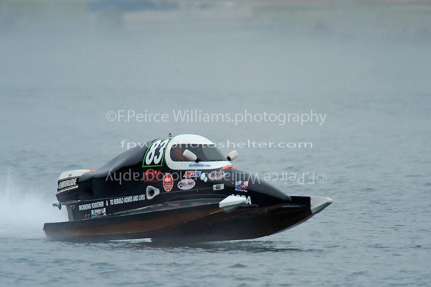 Antonio Degugas, (#83) races through the fog….  (SST-45 class)