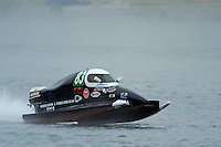 Antonio Degugas, (#83) races through the fog….  (SST-45 class)
