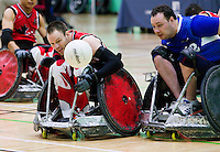15 AUG 2011 - LEEDS, GBR - Canada's Fabien Lavoie (left) and  Great Britain's Ross Morrison (right) chase a loose ball during the wheelchair rugby exhibition match between the two teams .(PHOTO (C) NIGEL FARROW)