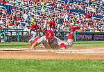 7 September 2014: Philadelphia Phillies outfielder Grady Sizemore slides home safely against the Washington Nationals at Nationals Park in Washington, DC. The Phillies fell to the Nationals 3-2 in their final meeting of the season. Mandatory Credit: Ed Wolfstein Photo *** RAW (NEF) Image File Available ***
